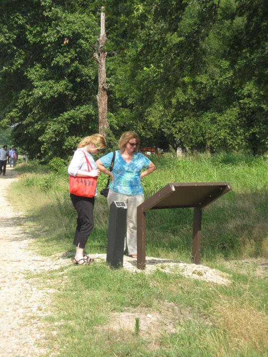 Rohwer visitors reading interpretive signage